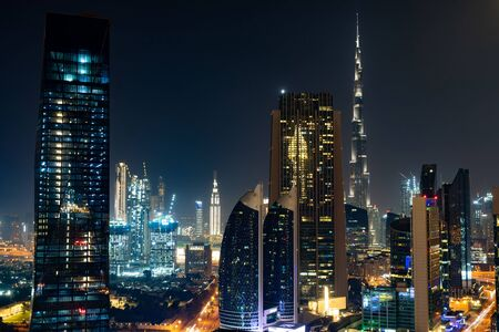 Dubai skyline in the night time, United Arab Emirates. Stock fotó
