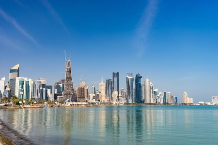 View of city center with skyscrapers from the other side of sea in Doha, Qatar. Standard-Bild