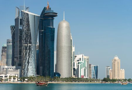 View of city center with skyscrapers from the other side of sea in Doha, Qatar.
