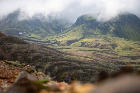 View mountain valley with green, foggy hills. Laugavegur hiking trail, Iceland. Stock Photo