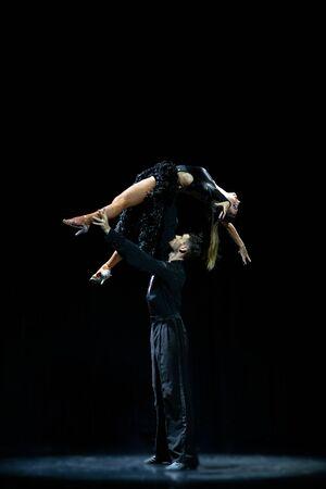 ballroom couple dancing isolated on black background.