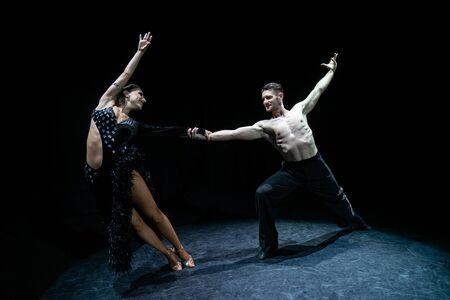 ballroom couple dancing isolated on black background