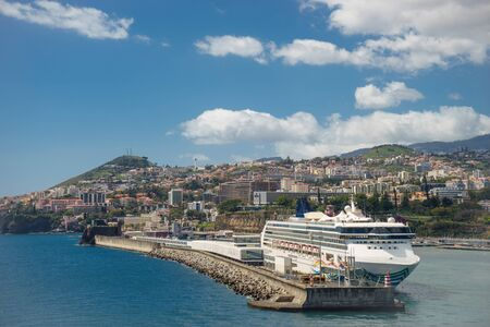 Large luxury white cruise ship at Seaport of Funchal, Madeira Island, Portugal