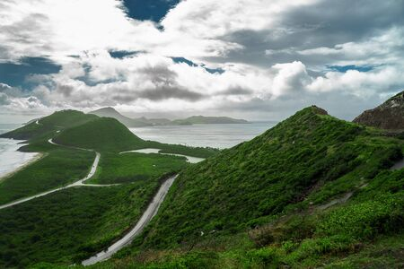 Landscape view of the Caribbean Sea and Atlantic Ocean looking south of St Kitts island from the top of Timothy Hill.