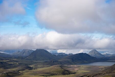 View mountain valley with green hills, river stream and lake. Laugavegur hiking trail, Iceland