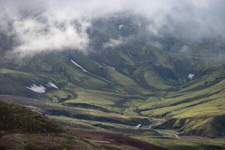 View mountain valley with green, foggy hills. Laugavegur hiking trail, Iceland Stock Photo