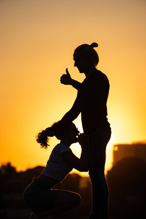 Silhouette of girl making blowjod for her man