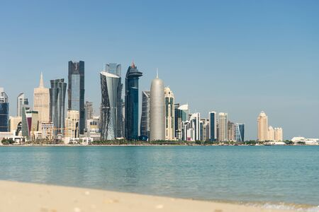 View of city center with skyscrapers from the other side of sea in Doha, Qatar 写真素材