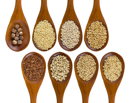 collection of grains in wooden spoon isolated on white background.