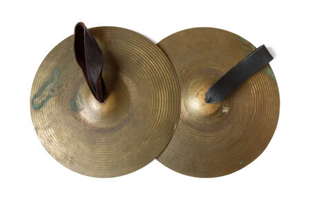 Old cymbals with leather handheld on white background, include path