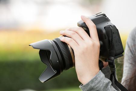 woman hand holding camera