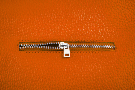 Rust color leather with unlocked zipper. photo