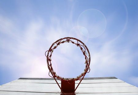 Basketball hoop in blue sky with flare light effect  Include clipping path  Stock Photo