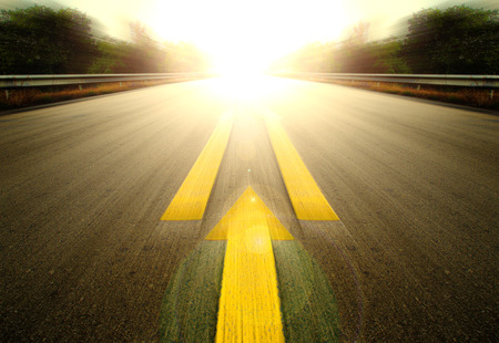 Road With Painted Yellow arrow Line. Stock Photo