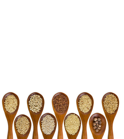 collection of grains in wooden spoon isolated on white  photo