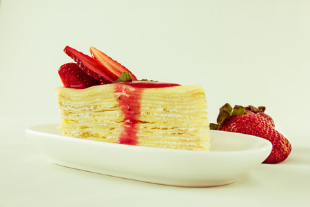 Strawberry crape cake with ripe strawberry, vintage style. photo