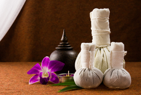 Spa herbal compressing ball with wooden casket and orchid Stock Photo