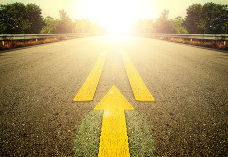 exceed: Road With Painted Yellow arrow Line. Stock Photo