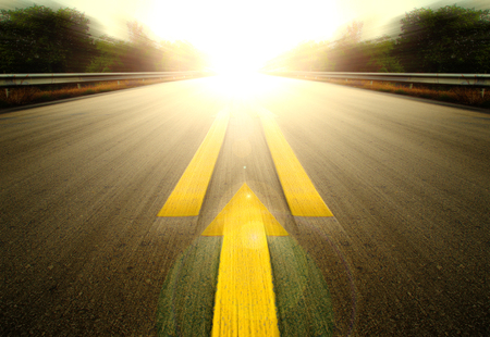 overtake: Road With Painted Yellow arrow Line. Stock Photo