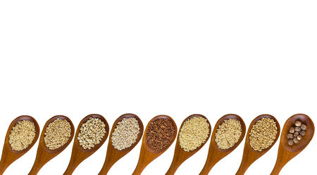 collection of grains in wooden spoon with separated shot isolated on white background. photo