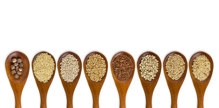 collection of grains in wooden spoon isolated on white background. photo