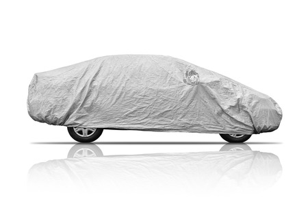 A car with cover sheet for sunlight, rain and dust protection photo