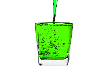 Green liquid splashing isolated on white background. with clipping path. photo