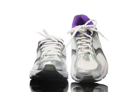 Pair of purple running shoes isolated on a white background. photo