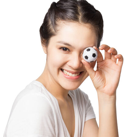 Smiley Asian woman holding small football isolated on white background. photo