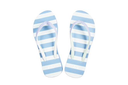 Blue flip flop sandals beach shoes isolated on white background. photo