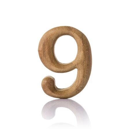 nine years old: wooden numeric with shadow isolated on white background, number nine, 9. Stock Photo