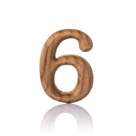 wooden numeric with shadow isolated on white background, number six,6. photo