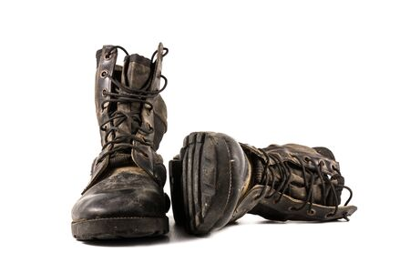 combat boots: A pair of old combat boots isolated on white background. Stock Photo