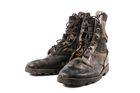 muddy clothes: A pair of old combat boots isolated on white background. Stock Photo