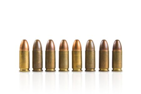 45 caliber: Group of old 9mm bullet for a gun isolated on white background. Stock Photo