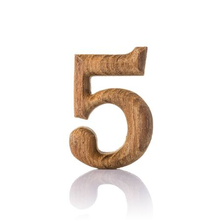 wooden numeric with shadow isolated on white background, number five,5. photo