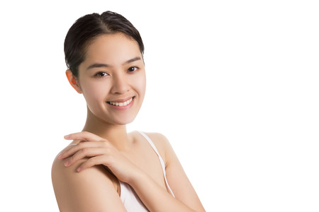Young Asian woman with smiley face and no makeup isolated on white background.