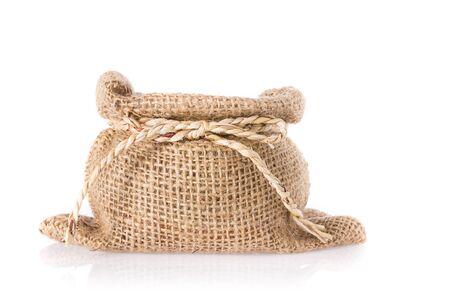 gunny: Empty burlap sack with straw ribbon isolated on white background.