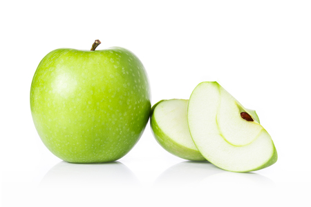 Green apples and apple slices isolated on white background.