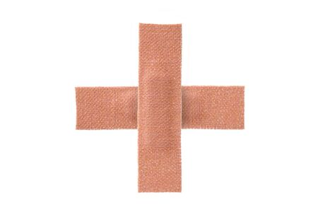 firstaid: Sticky fabric plaster first-aid equipment isolated on white background.