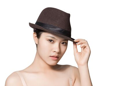 uplift: Young Asian woman wearing fedora isolated on white background.