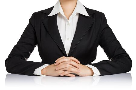 clasped hand: Business woman body with hand clasped on table isolated on white background.