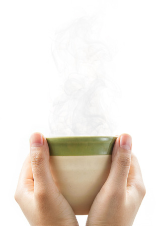 Hands holding green tea cup with isolated on white background.
