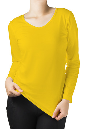 long sleeves: woman body in a yellow long sleeves t-shirt isolated on white background. Stock Photo