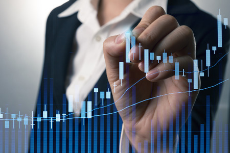 stock graph: Businessman writing analyze graph for trade stock market on the screen. Stock Photo