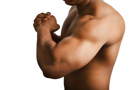 arm muscles: Muscular male showing big arm muscles isolated on white background.