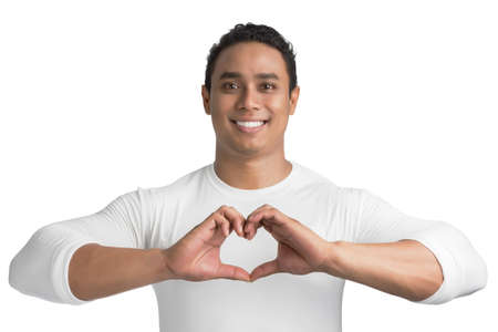 adult hand: Young Asian man make heart shape by his hand isolated on white background.