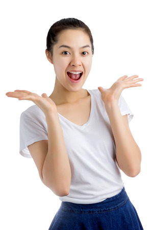 Young Asian woman smiling with open mouth and open palms, surprise expression. Isolated on white background.
