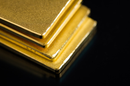 metal bars: Gold bar on black background. Stock Photo