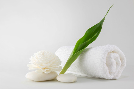 white towels: Spa towel decorated with green leave handmade, flower and white stone